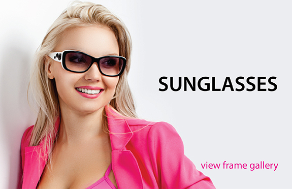 female in pink costume wearing designer sunglasses